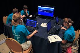 This photo features a group of CyberPatirots competing in the National Finals Competition. Being a CyberPatiot requires hard work, determination, and focus on the codes.
