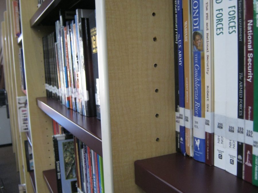 Books on shelves in the Faith Lutheran Library. Librarian Ms. Bowline believes that reading at Faith is becoming more popular than in years past.