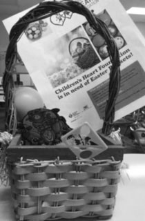 This is a photo of  a  Easter basket full of fun toys and supplies.  This can be donated the CHF for a child to enjoy Easter, and have a good time.