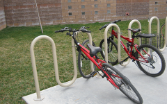 Two bicycles lay on a rack outside Faith Lutheran. Students who bicycle to school report feeling more energized and ready to attend school each day.